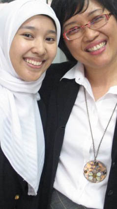 this is Fany (left, the one who use hijab) wit Ms. Riama (our lecturer), right after she graduate